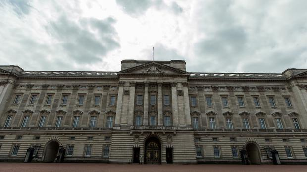 Buckingham Palace staff have been axed in a cost-cutting move
