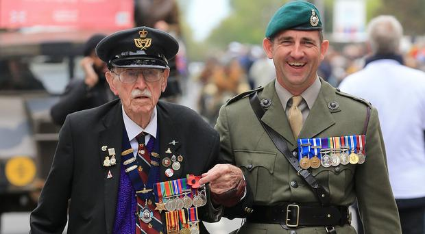 Dunkirk veteran Arthur Taylor leads a military parade through Dunkirk accompanied by his grandson
