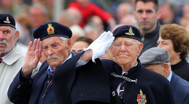 Dunkirk veterans (left) Michael Bentall and Garth Wright salute during a service at the Allied Beach Memorial on the 75th anniversary commemorations of Operation Dynamo
