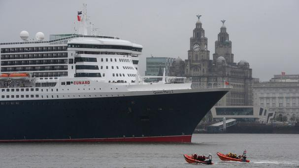 Cunard ocean liner the Queen Mary 2 arrives in Liverpool ahead of Cunard's 175th anniversary celebrations, when she will be joined by the Queen Victoria and Queen Elizabeth.