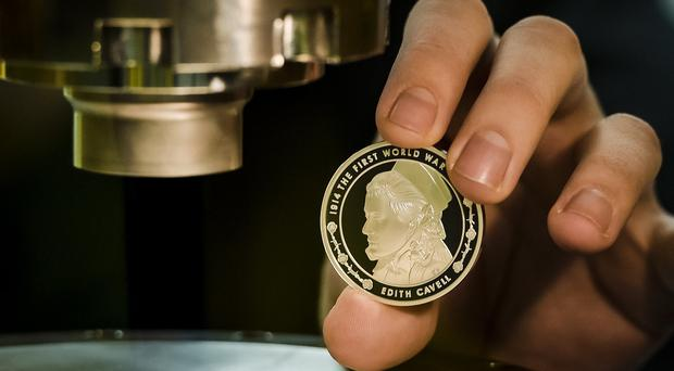 A freshly minted five-pound coin featuring Edith Cavell, who was a nurse during the First World War and was executed by firing squad