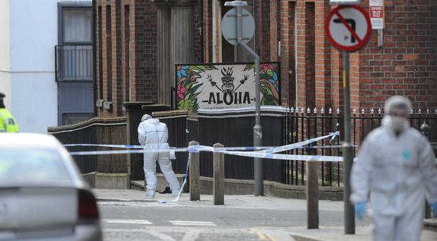 Police at the scene of the fatal attack on Neil Doyle