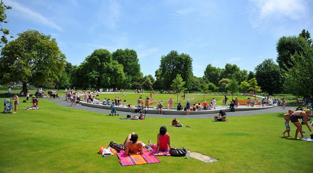 People enjoy the hot weather as they relax by the Diana Memorial Fountain in Hyde Park, London.