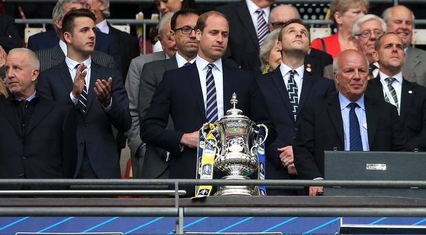 The Duke of Cambridge, pictured with the FA Cup, urged sponsors to press for reform of Fifa