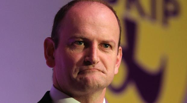 Ukip MP Douglas Carswell labelled comments by Nigel Farage about immigrants coming to Britain for free treatment for HIV as 'plain wrong' and 'mean-spirited'