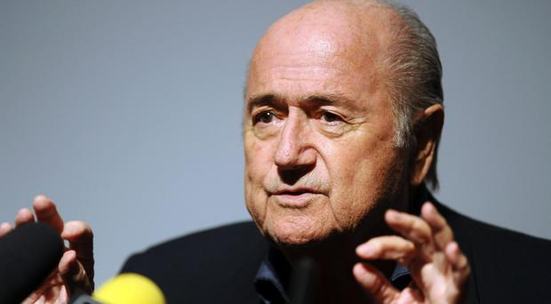 Under-fire Fifa president Sepp Blatter was re-elected on Friday