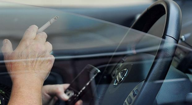 Welsh Government officials say the police will enforce any new regulations on smoking in cars 'in conjunction with their wider road safety duties'