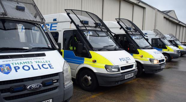 Police vans before dawns raids in which eight men were arrested by police investigating child sexual exploitation offences against girls stretching back 16 years (Thames Valley Police/PA)