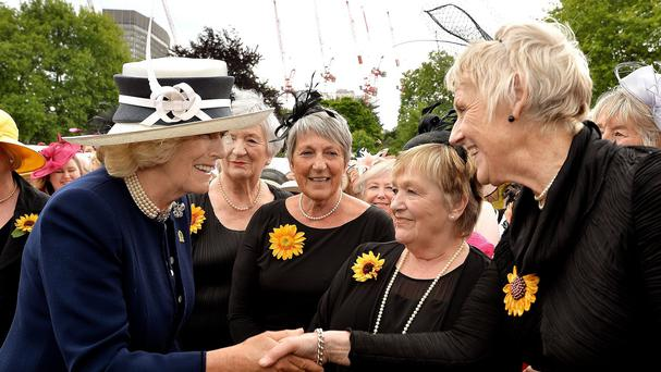 The Duchess of Cornwall talks with the Calender girls (left to right) Lynda Logan, Angela Baker, Ros Fawcett and Patricia Stewart