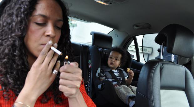 Smoking in cars is to become illegal in Wales (British Lung Foundation/PA)