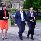 First Minister Peter Robinson (centre) with Finance Minister Arlene Foster and Nigel Dodds before a meeting of political leaders at Stormont in a bid to prevent the collapse of the institutions