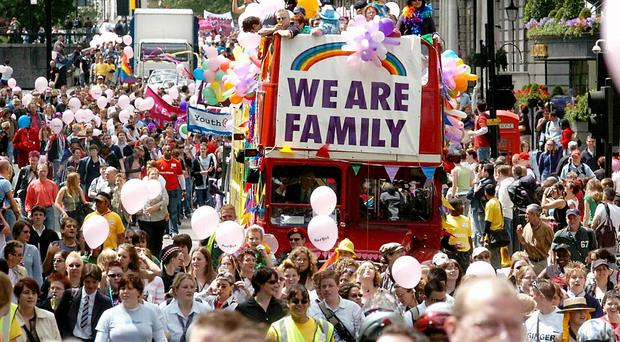Thousands take part in the 26th annual Gay Pride Festival parade, as they march through London