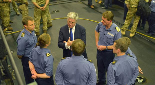 Defence Secretary Michael Fallon during a visit to HMS Bulwark off the coast of Libya, North Africa, as it assists in the rescue of migrants attempting to reach Europe.