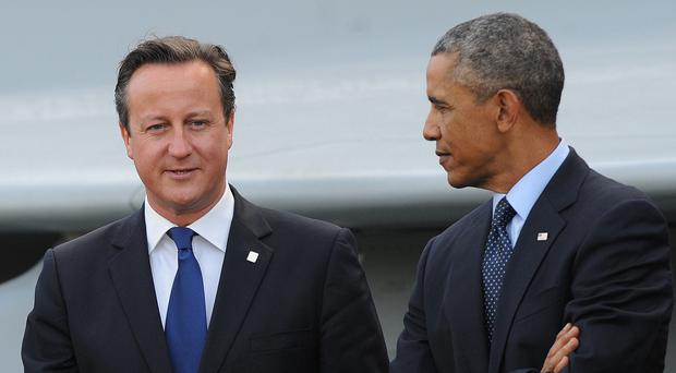 David Cameron will discuss Britain's defence spending with Barack Obama