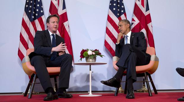 US President Barack Obama and British Prime Minister David Cameron in a bilateral meeting during the G-7 summit