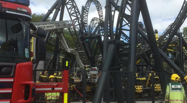 The scene at Alton Towers after four teenagers have suffered serious leg injuries in a collision between two carriages on the amusement park's Smiler rollercoaster
