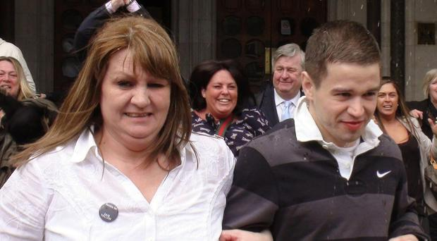 Sam Hallam left the Court of Appeal in London, with his mother Wendy, after he was freed on bail in 2012