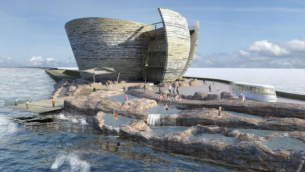 An artist's impression of how the world's first tidal lagoon power plant may look in Swansea Bay, South Wales (Tidal Lagoon Power).