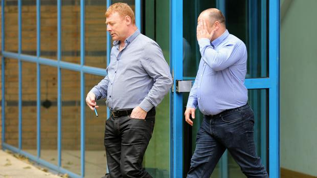 Martin McGlinchey (left) and Stephen McLaughlin leave Basildon Crown Court where they and two other men deny their involvement in a people-smuggling operation