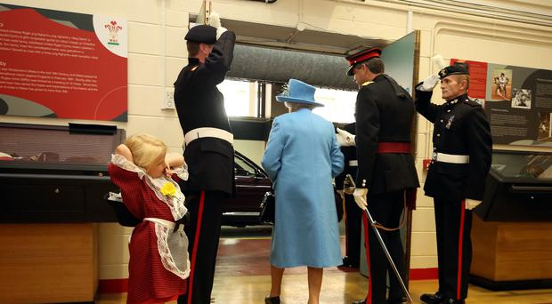 Six-year-old Maisie Gregory's hat was knocked off by a saluting soldier