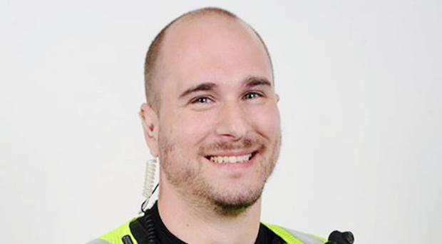 Pc Chris Stevens was captured on camera walking arm-in-arm with an elderly man who had been struggling with his shopping (Northamptonshire Police/PA)