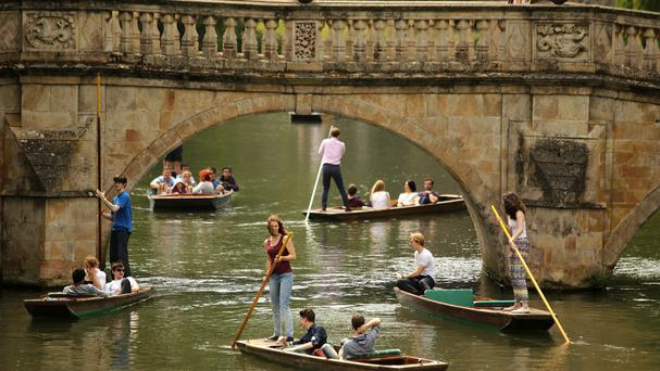 Sunshine brought tourists out to take a punt along the river Cam in Cambridge