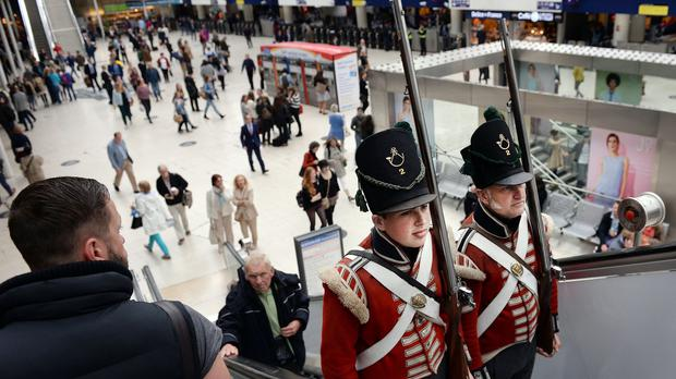 Re-enactment soldiers take the escalator at Waterloo Station, London, as part of events to mark the Battle of Waterloo's 200th anniversary