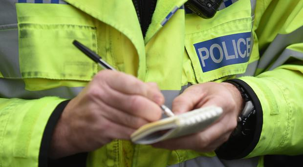 Police have launched a manhunt after the body of a woman was discovered.