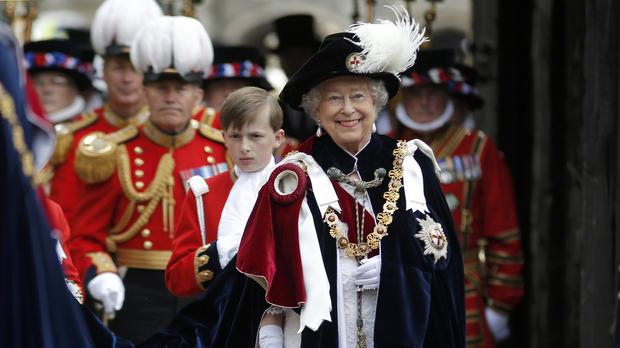 The Queen walks in procession ahead of the annual Order of the Garter Service at St George's Chapel, Windsor Castle