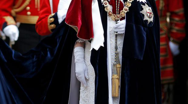 The Queen smiles as she attends the Most Noble Order of the Garter Ceremony at Windsor Castle