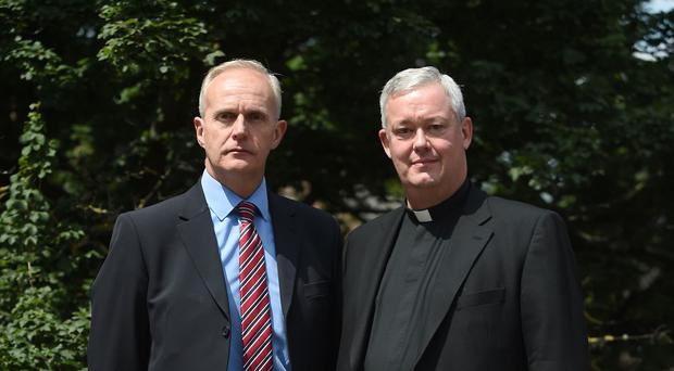 Canon Jeremy Pemberton with his husband Laurence Cunnington