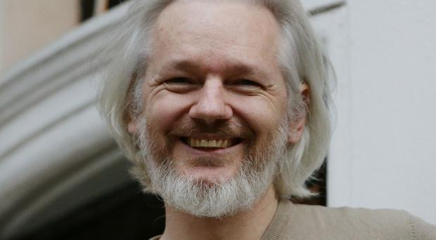 Julian Assange on the balcony of the Ecuadorian Embassy in Knightsbridge, London, last year