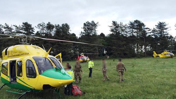 The air ambulance at the scene of a crash between three troop carriers on Salisbury Plain (Wiltshire Air Ambulance/PA)