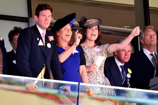 Sarah Ferguson (second left) and Princess Eugenie cheer during day four of Royal Ascot