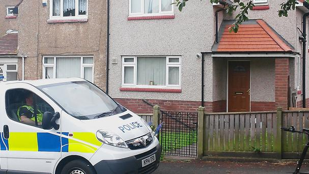 Police outside a house in Falkland Road, Sunderland, where a baby has died after he was bitten by a dog