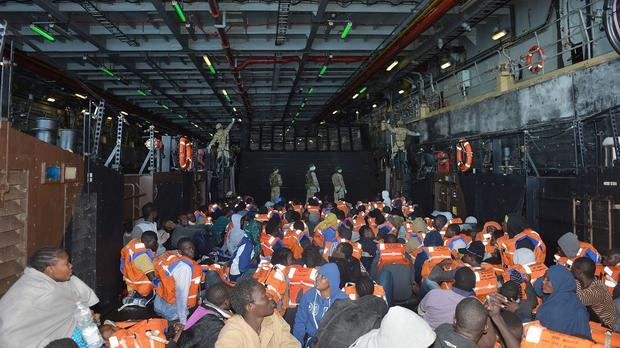Migrants in the safety of HMS Bulwark's dock after their rescue in the Mediterranean