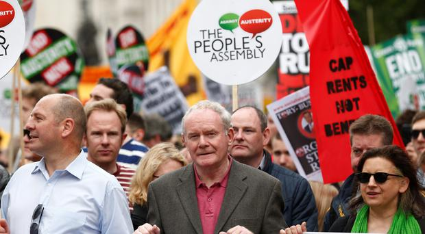 Deputy First Minister Martin McGuinness (centre) joins the London march to protest against the Government's spending cuts
