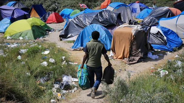 Migrants camp in squalid conditions in Calais