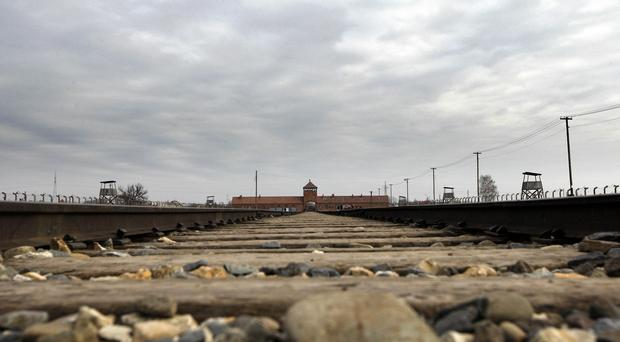 Two British teenagers have been arrested on suspicion of theft at the Auschwitz-Birkenau camp