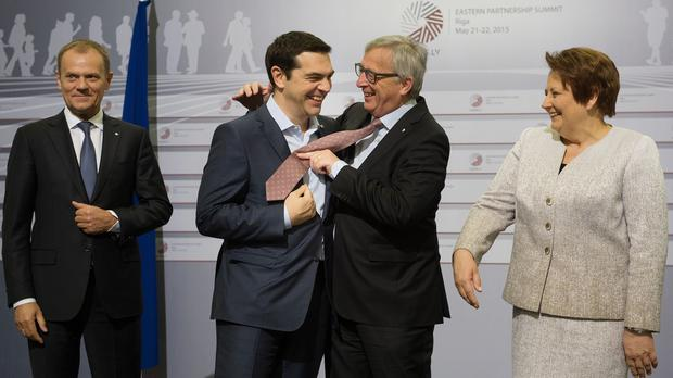 Alexis Tsipras and Jean-Claude Juncker are seeking solutions to the impasse