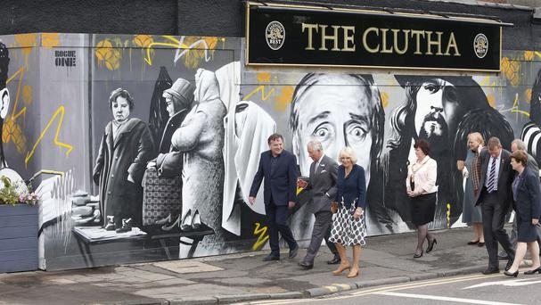 Charles and Camilla have visited the Clutha bar in Glasgow, where 10 people died in a helicopter crash in 2013