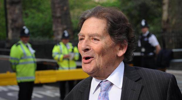 Lord Lawson said cutting the top rate of income tax would attract business to Britain