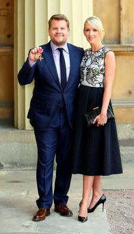 James Corden with wife Julia Carey after he was awarded an OBE