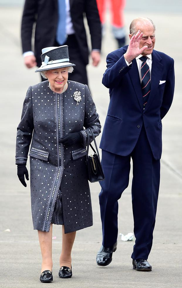 The Queen and Prince Philip arrive at the military airport of Celle in Germany yesterday