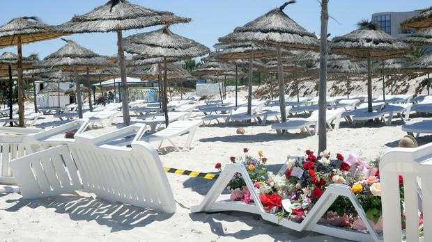 Flowers are laid at the scene of Friday's shooting attack in the coastal town of Sousse, Tunisia (AP)