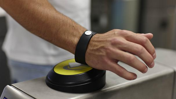 A bPay wristband was launched in June 2014 and registrations for it spiked after Transport for London went contactless in September (PA/Transport for London)