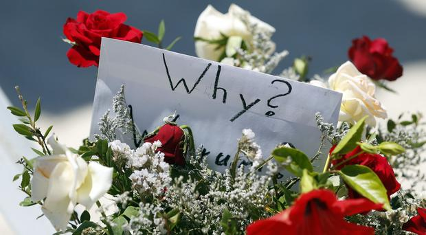 Flowers at the scene of the massacre in Sousse as sources warned the British death toll could rise to at least 30 (PA)