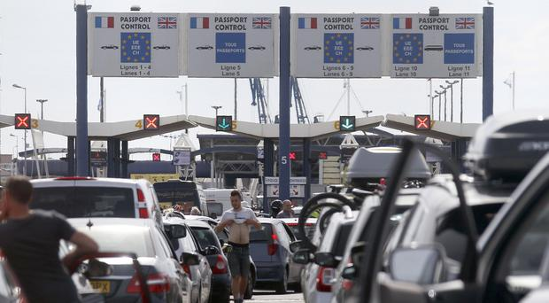 Ferry passengers heading to the UK queue at the terminal in Calais amid industrial action (AP)