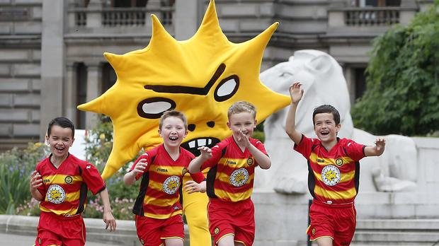 Partick Thistle launch their 2015/16 home kit with their mascot Kingsley and a number of young fans