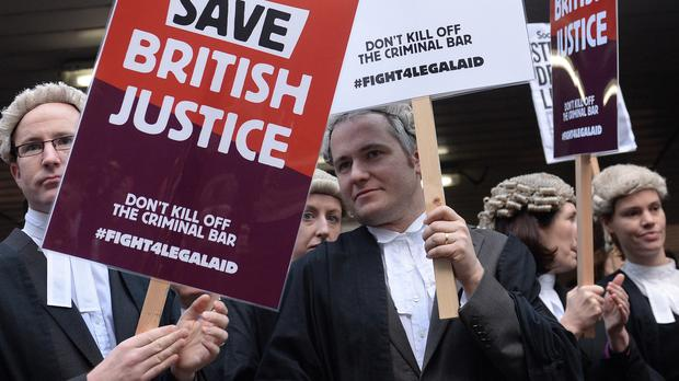 Barristers and solicitors demonstrate outside Southwark Crown Court during a nationwide strike against government plans to cut legal aid fees